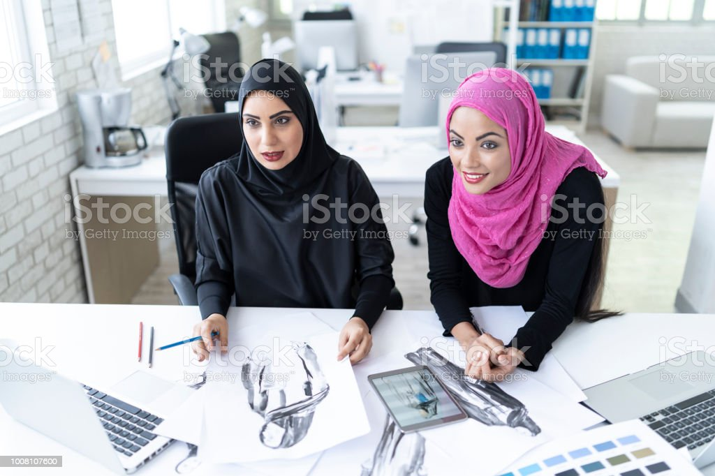 Two Fashion Designers Choosing Colors And Models In Studio Stock Photo Download Image Now Istock