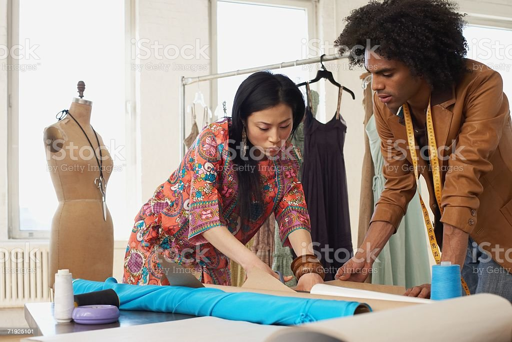 Two fashion designers working stock photo