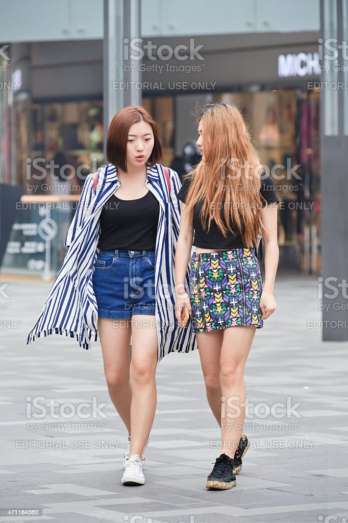 Two fashionable girls at Beijing The Village shopping area stock photo