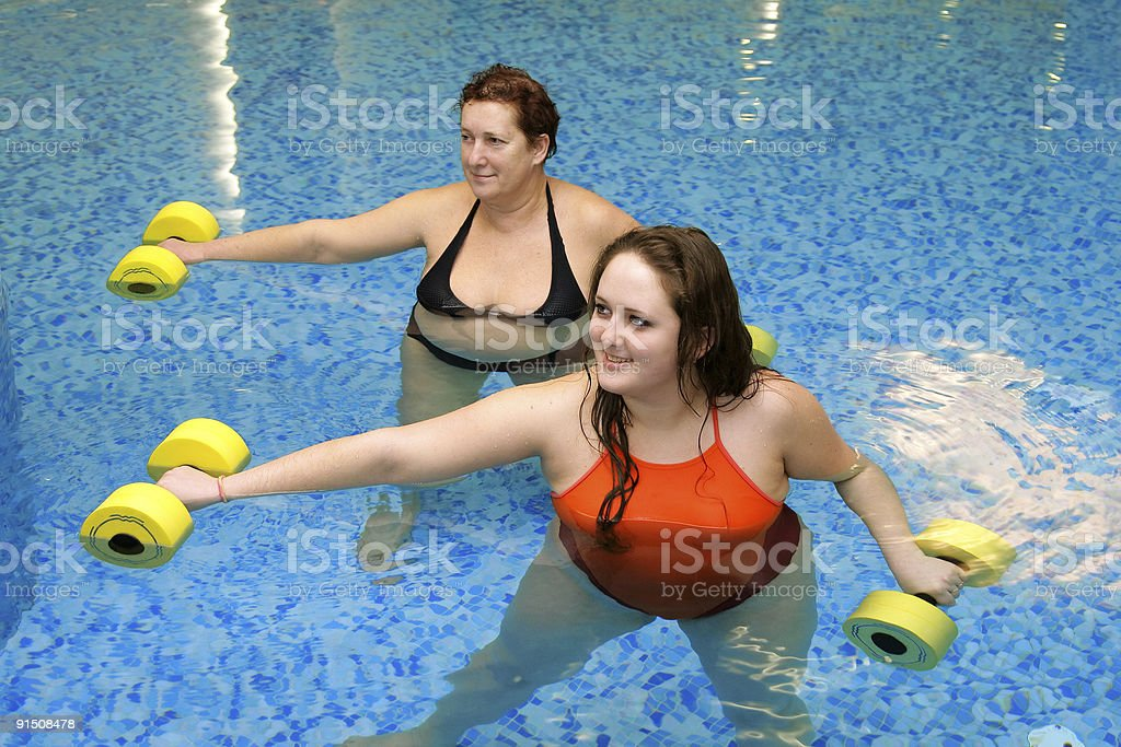 Two fat  women in water on training royalty-free stock photo