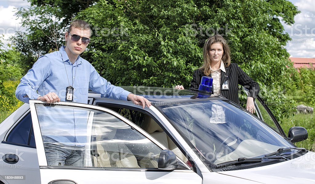 Two FBI agents near the car with flasher stock photo