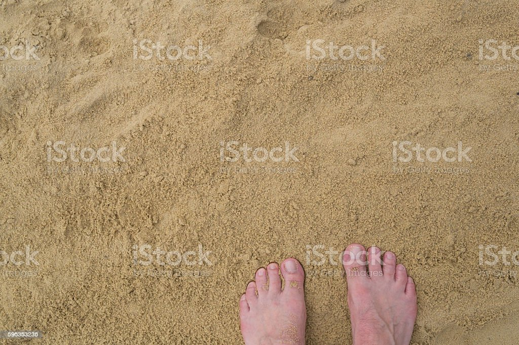 Two feet on sand royalty-free stock photo