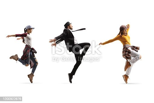 Full length profile shot of two female and one male dancers performing a choreography isolated on white background