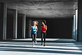 Two female athletes running together