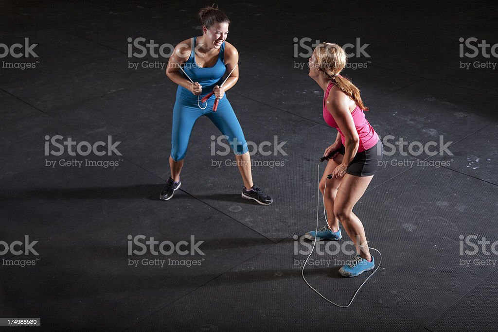 Two female athletes with jump ropes stock photo