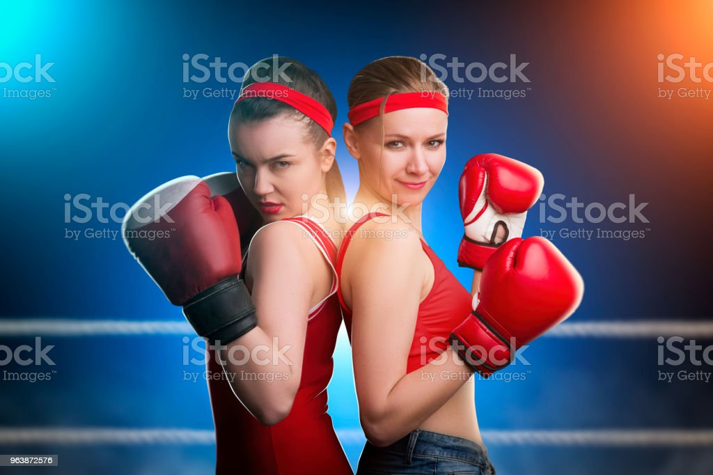 Two female boxers standing back to back - Royalty-free Adult Stock Photo