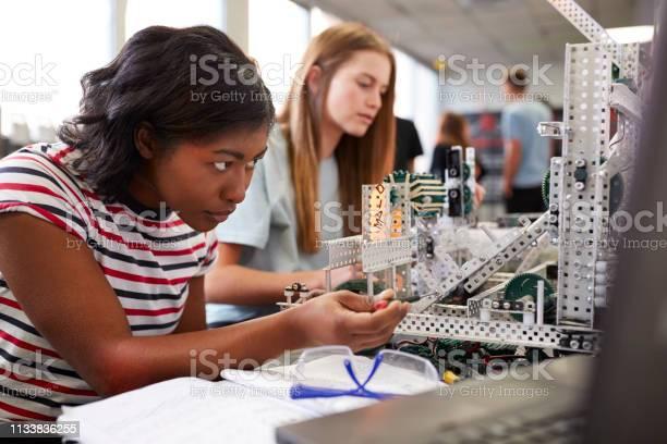 Two female college students building machine in science robotics or picture id1133836255?b=1&k=6&m=1133836255&s=612x612&h=kteppcnlbgg79zvrntwmxrbxtfzt9qyo0eatpph6oc8=