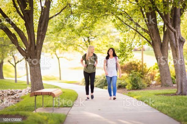 Two female college students on college campus picture id1024120032?b=1&k=6&m=1024120032&s=612x612&h=vimtygdfvltlq cvfd029 mzmfsrfq0dfq22m9w5ddg=