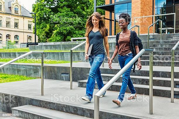Two female college students walking on campus picture id636927620?b=1&k=6&m=636927620&s=612x612&h=0sgwmwqa1imbf2wkqjzxaqfq 1vz6kqhyfih5gwpp e=