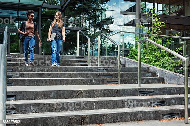 Two female college students walking on campus picture id636927662?b=1&k=6&m=636927662&s=612x612&h=na3ff41z267d1lbc4eohs2lq5mjofw3h5svzbeuahzo=