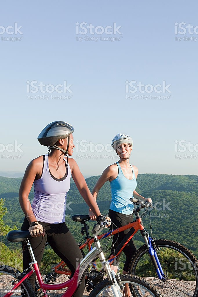 Two female cyclists, rural scene royalty-free stock photo