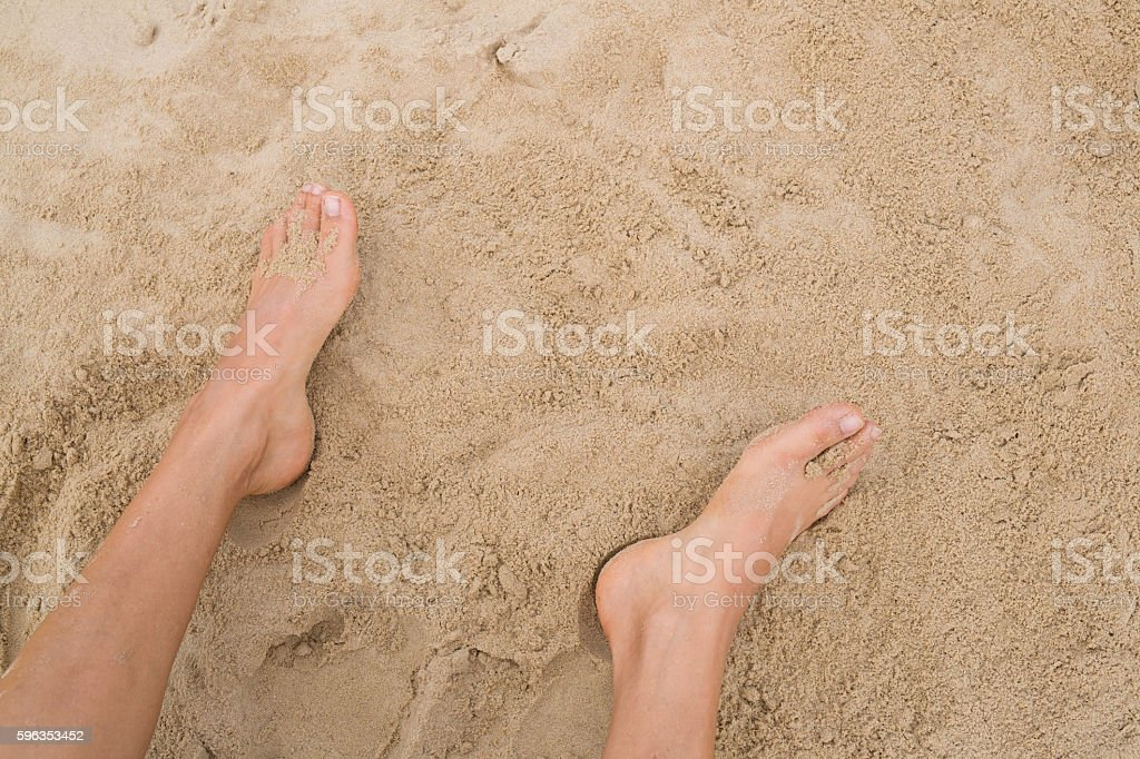 Two female  feet on sand royalty-free stock photo