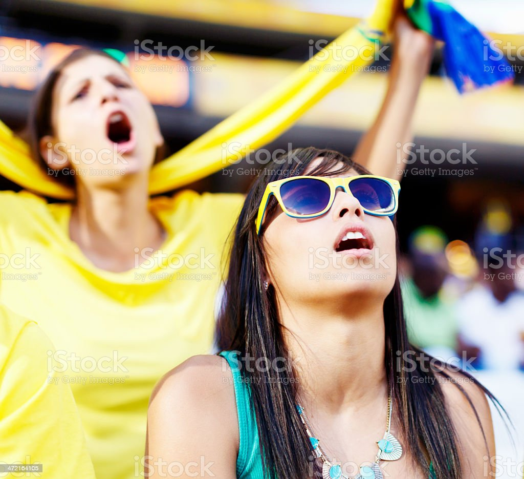 Two female football fans gasp, horrified by a missed goal royalty-free stock photo