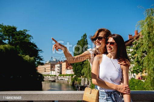 istock Two female friends enjoying the day in park 1168928563