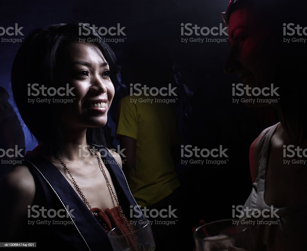 Two female friends in night club royalty-free stock photo