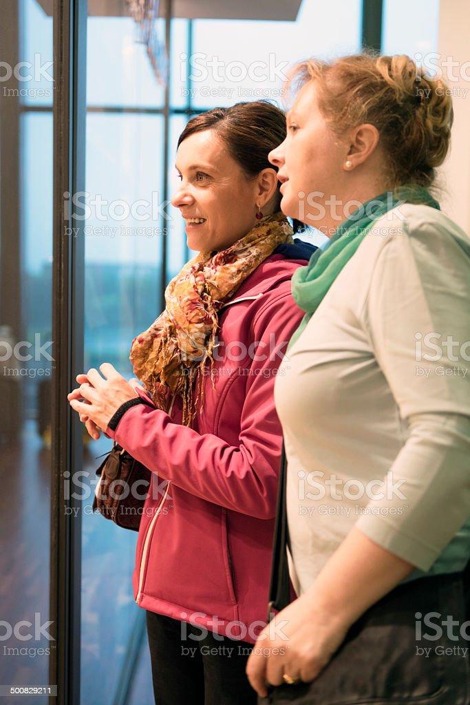 Conversation between two friends in airport
