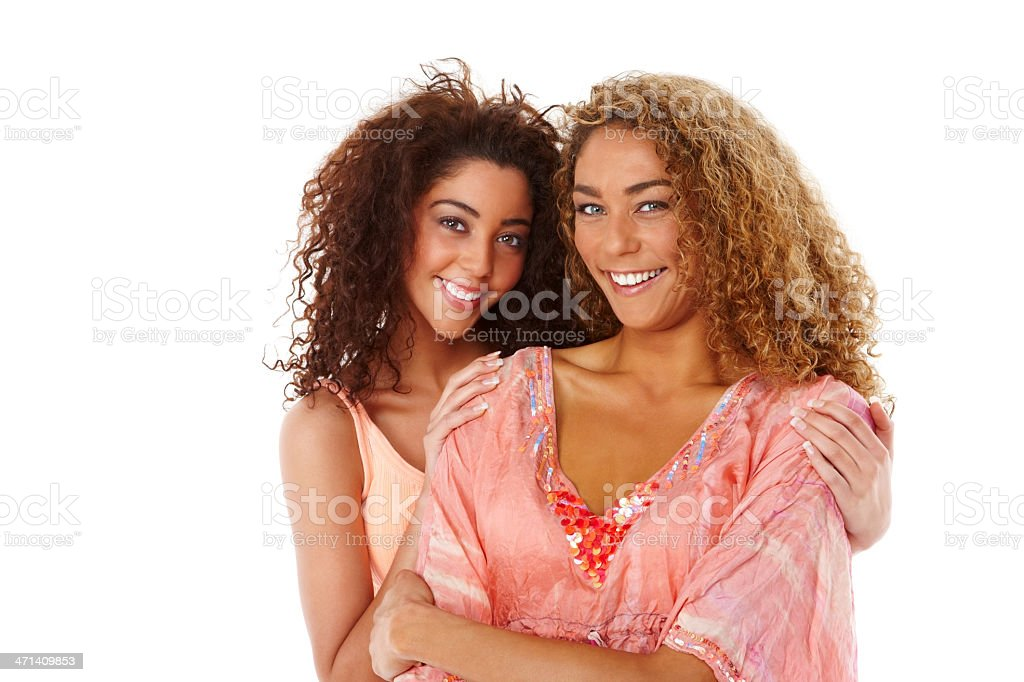 Two female friends smiling together stock photo