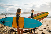 Surfing is a way of living in Australia and young and mature sporty women go surfing every morning.