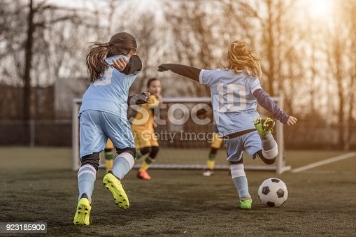 istock Two Female Girl Soccer Teams playing a football training match in the Spring outdoors 923185900