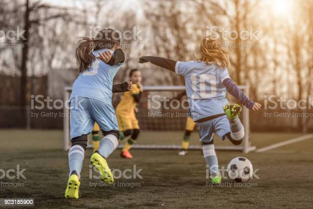 Two female girl soccer teams playing a football training match in the picture id923185900?b=1&k=6&m=923185900&s=612x612&h=cmzjmkomnrmfox4bjwoionfaih7hhvuznaggfwecvim=