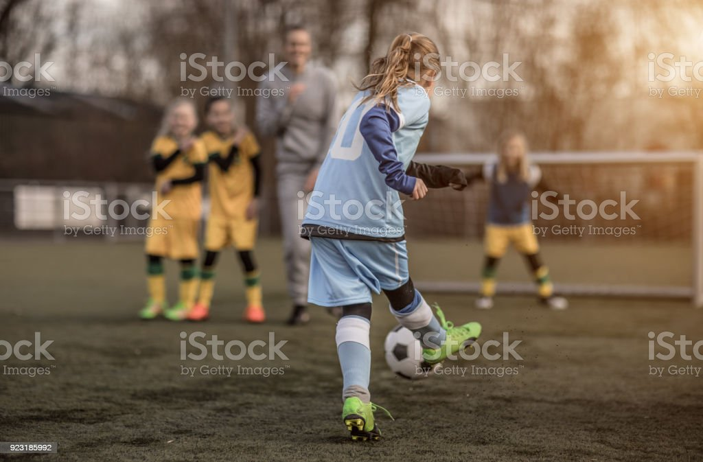 Two Female Girl Soccer Teams playing a football training match