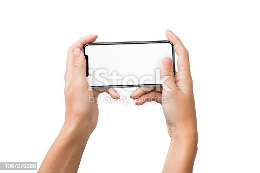 istock Two female hands holding smartphone and playing games 1087270366