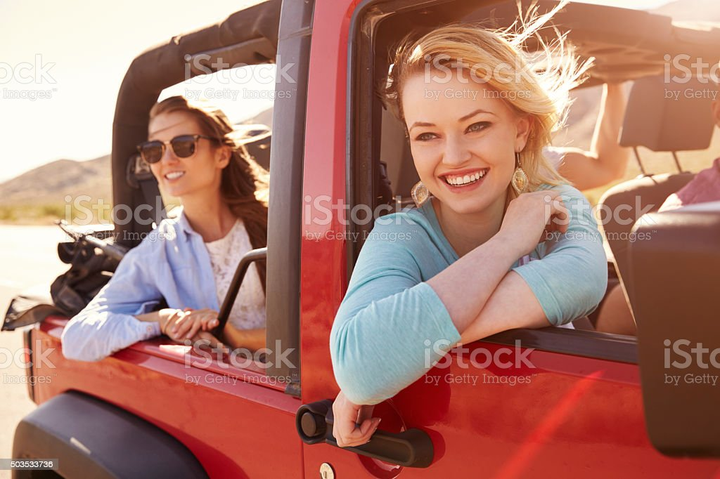Two Female Passengers On Road Trip In Convertible Car stock photo