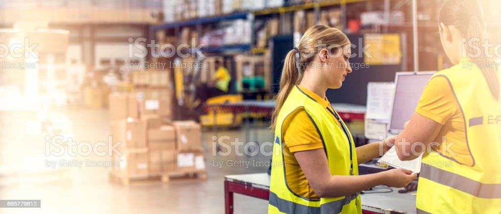 Two female postal workers royalty-free stock photo