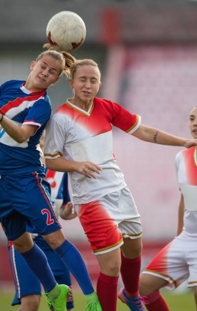 Two female soccer rivals heading the ball on a match picture id1202672866?b=1&k=6&m=1202672866&s=612x612&w=0&h=pko2mfzdw6rkydmprbhf10 lek5 rxzxmvvd6ld7gna=