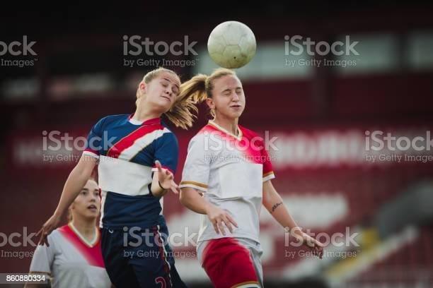 Two female soccer rivals heading the ball on a match picture id860880334?b=1&k=6&m=860880334&s=612x612&h=zjhw4k5kelgnru xocnuxr9ta1xqhvb5c02p xtb0do=