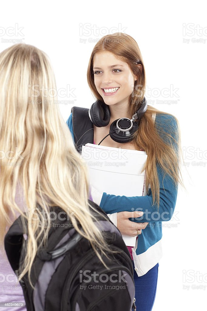 Two female student having conversation. royalty-free stock photo