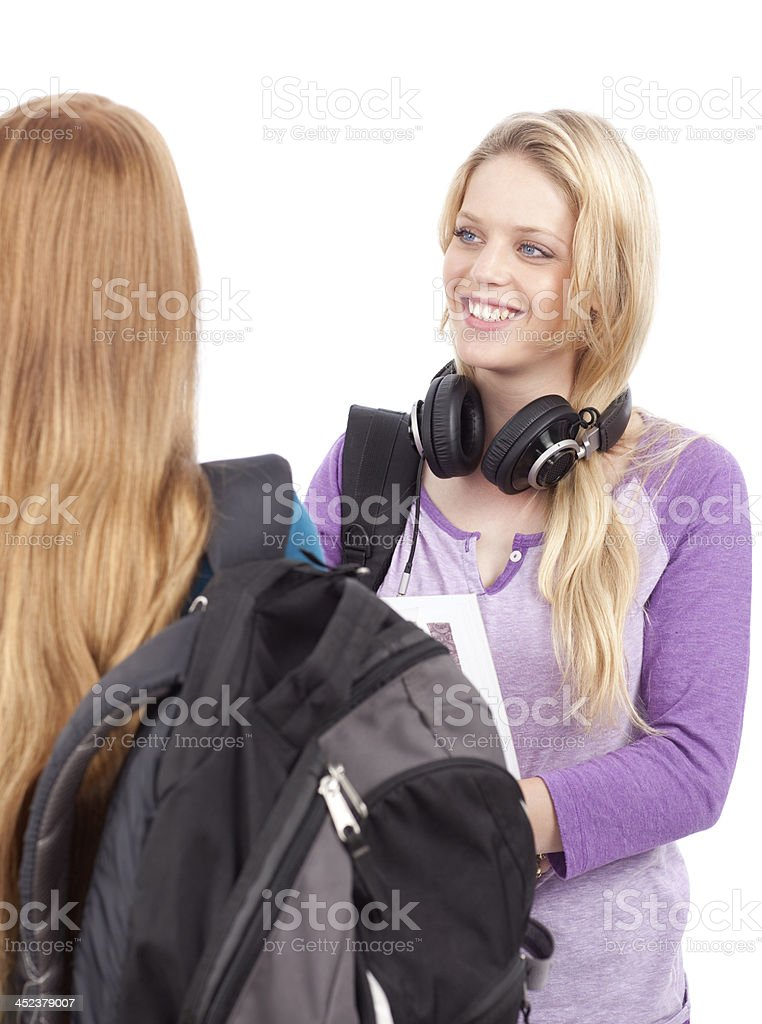 Two female student having friendly conversation. royalty-free stock photo