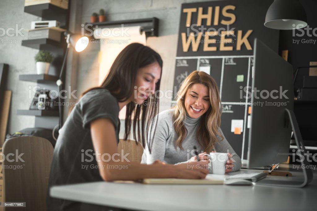 Two female web designers stock photo