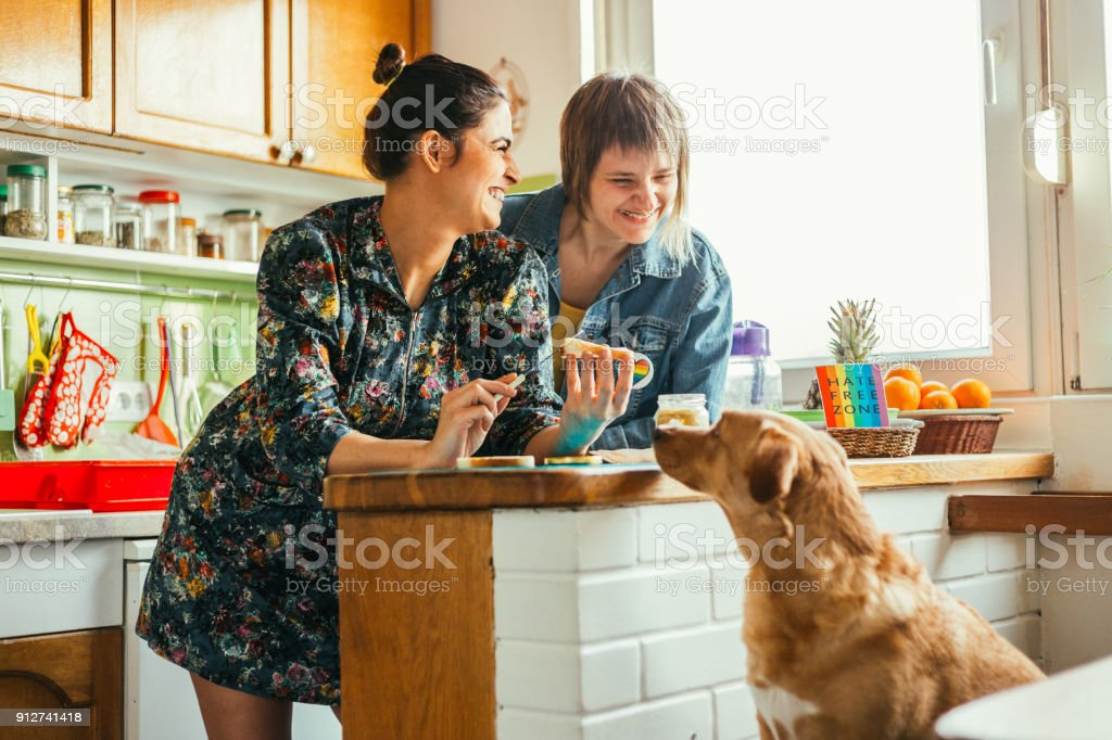 Two females enjoing breakfast at home stock photo