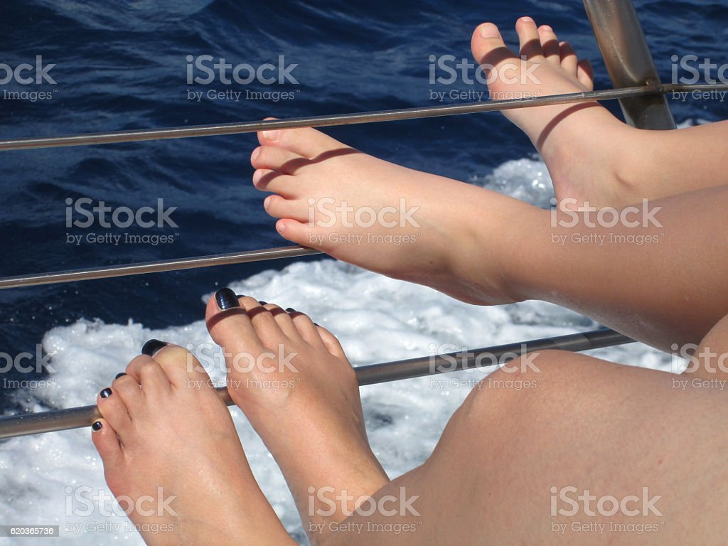 Two Female's feet relaxing on a boat foto de stock royalty-free