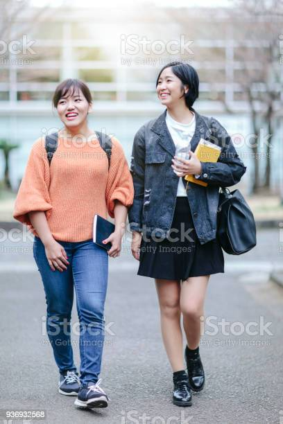 Two females students walking to lesson picture id936932568?b=1&k=6&m=936932568&s=612x612&h=anhsk7duh87hn6k  bgog6gbzx3vol4animjqqmwpei=