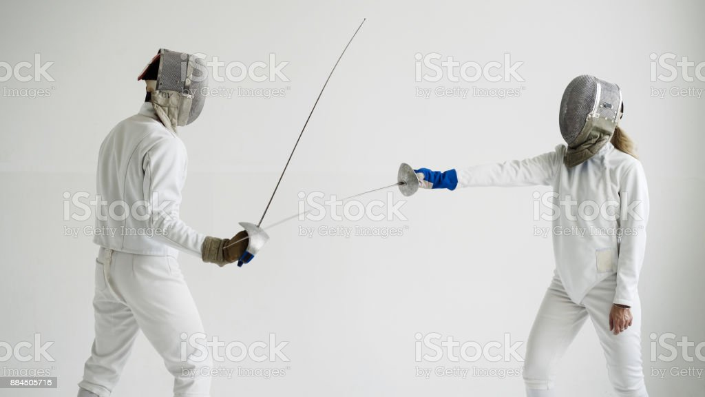 Two Fencers Having Training Attack And Defence Exercises In Fencing