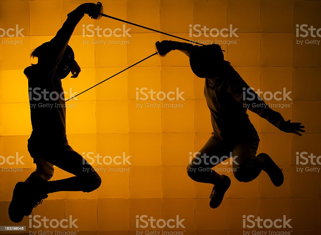 Two Fencers Jumping royalty-free stock photo