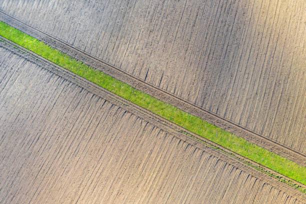zwei felder in der wintersonne von oben - aerial view soil germany stock-fotos und bilder
