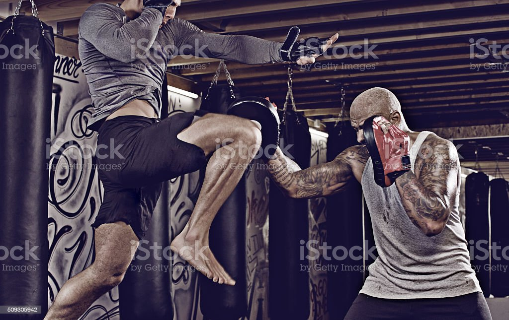 Two fighters sparring at an urban boxing gym stock photo