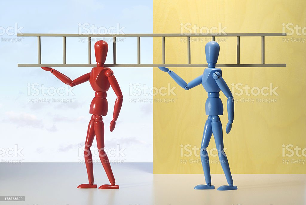 Two figures carry a ladder. stock photo