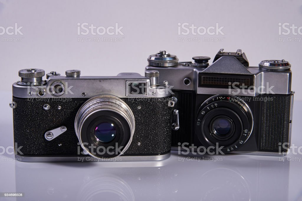 Two film cameras on a light background, which were made in the middle of the twentieth century stock photo