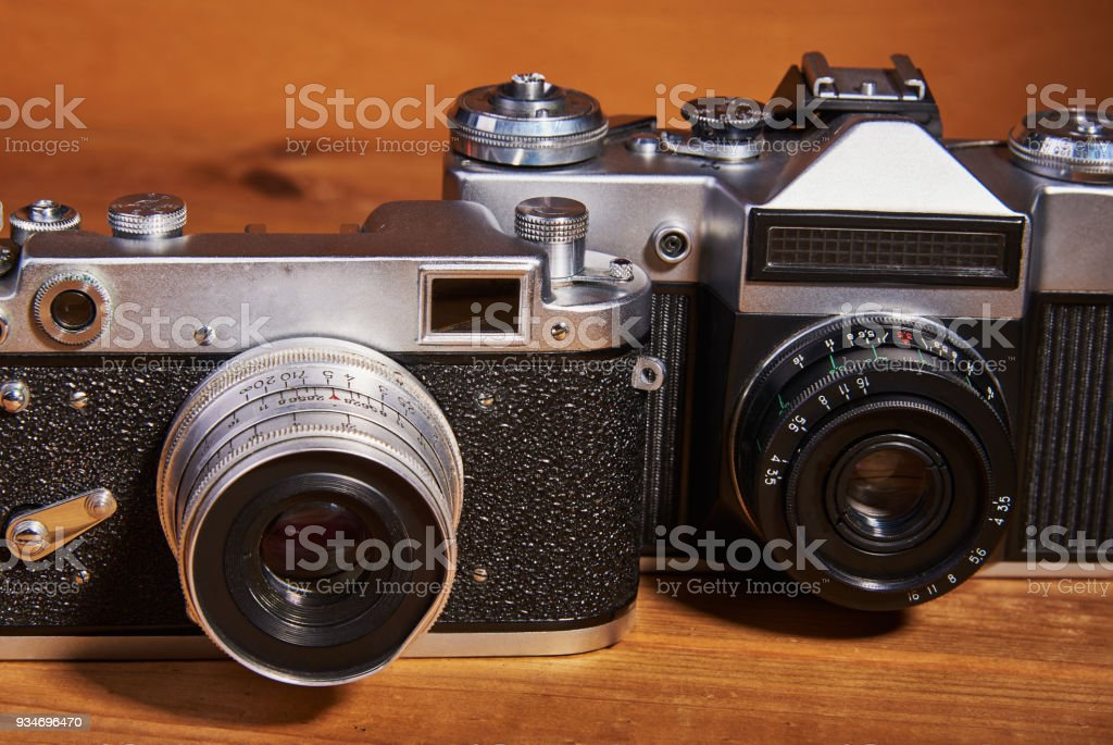 Two film cameras (analog cameras) that were made in the middle of the twentieth century stock photo