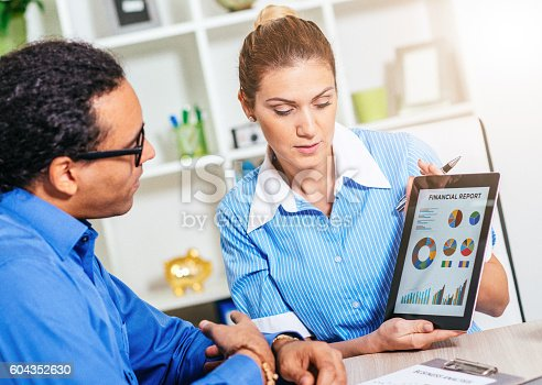 istock Two financial experts sharing information about stock market 604352630