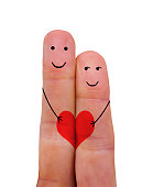 istock Two fingers with the faces of a couple. Love concept 1298620908