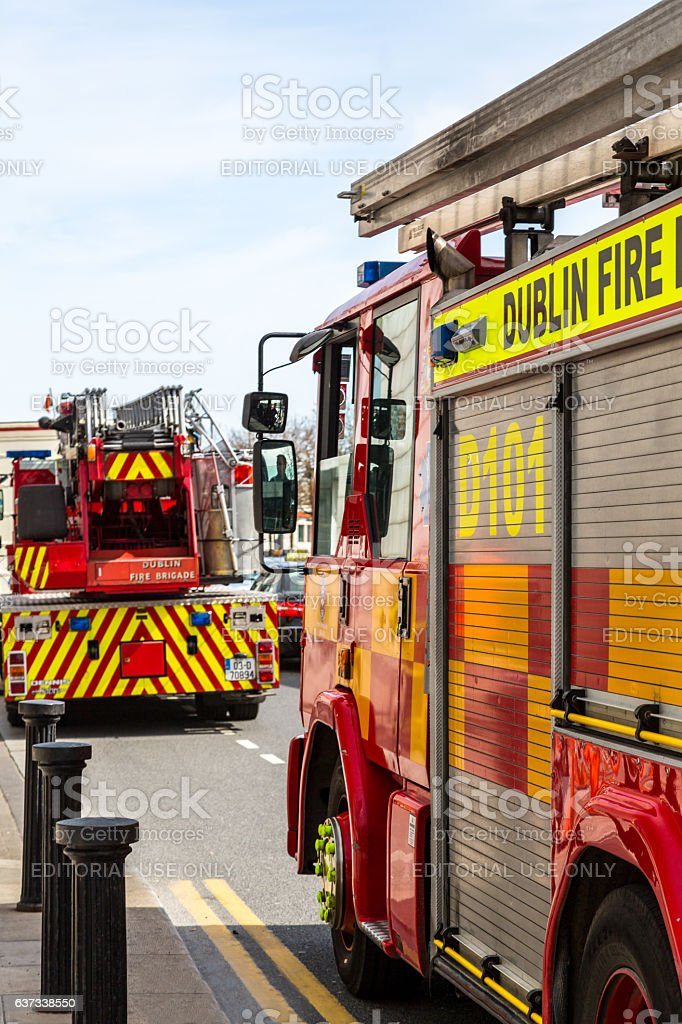 Two fire engines on a city street. stock photo