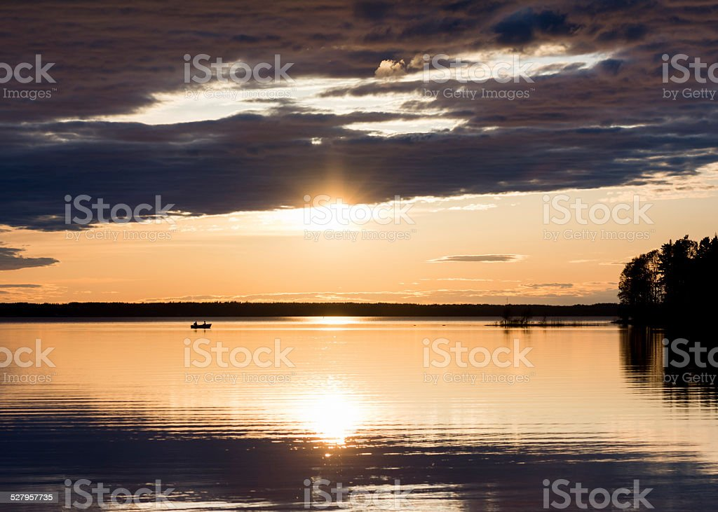 Two fisherman in a boat in the afternoon royalty-free stock photo
