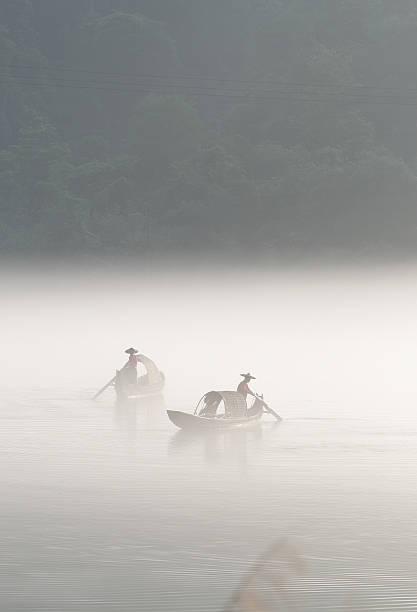 Zwei Fischer im Nebel – Foto