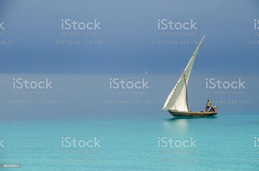 Two fishermen sailing stock photo