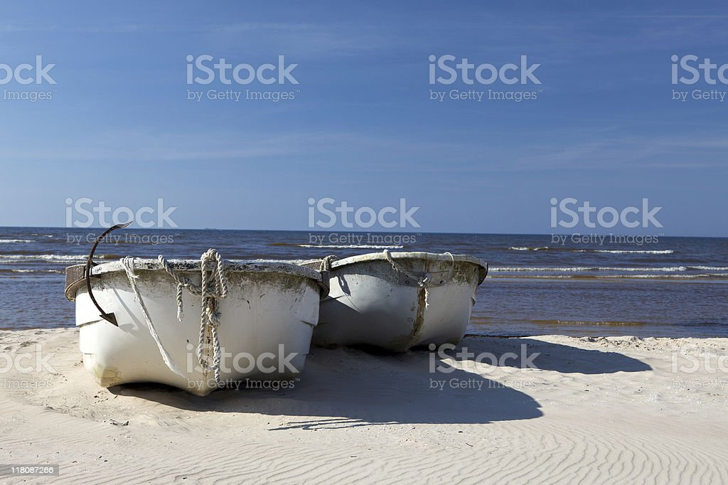 Two fishing boats on the beach royalty-free stock photo